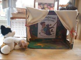 A puppet theatre was set up to reflect the storytelling acted out by the little girl and her cat in the book.